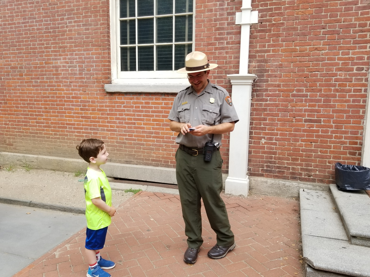 Receiving a Trading Card from a Park Ranger at Congress Hall