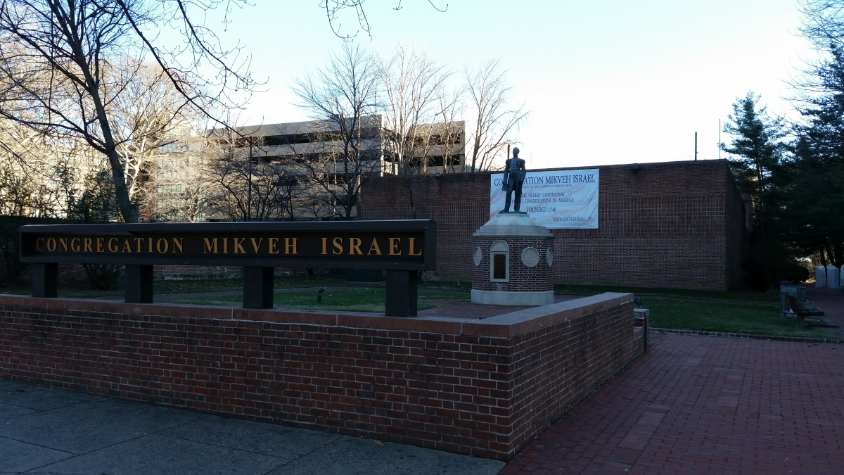 Mikveh Israel as seen from Independence Mall with statue of Uriah P. Levy