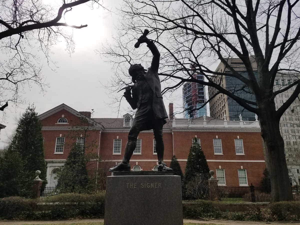 "The statue of ""The Signer"" in Signers' Garden is based upon George Clymer"