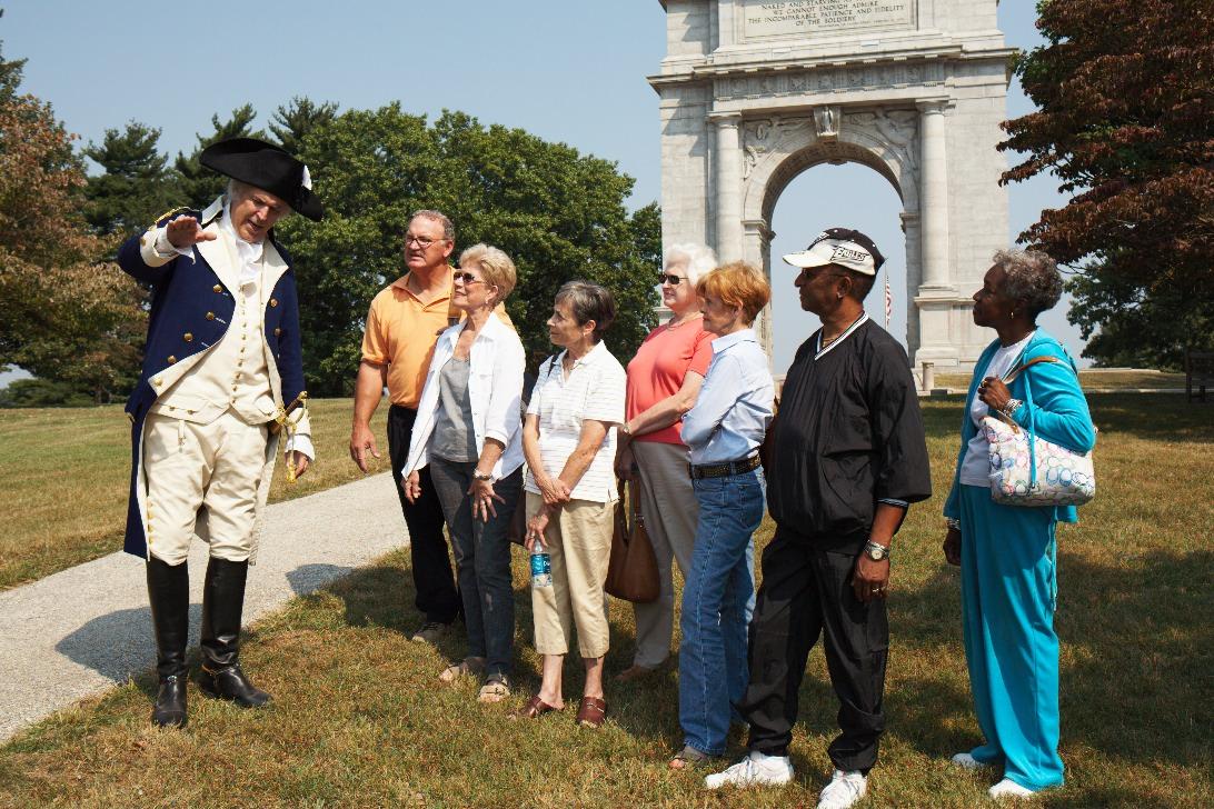 A tour at valley forge being led by a George Washington interpreter. Source: ValleyForge.org